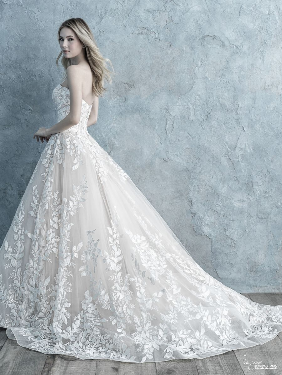 Lace strapless A-line wedding dress with leaf detailing.